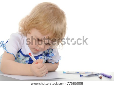 The little girl draws. On a white background.