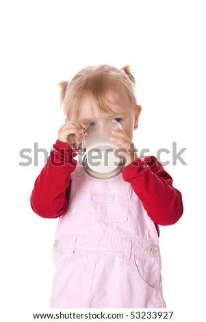 the little girl drinks milk - stock photo