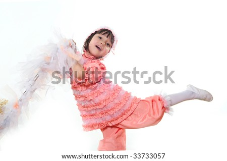 The little girl has lifted a foot upwards - stock photo