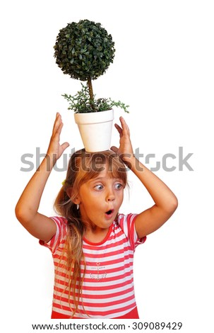 The little girl holds a flowerpot on the head, isolated on white background. - stock photo