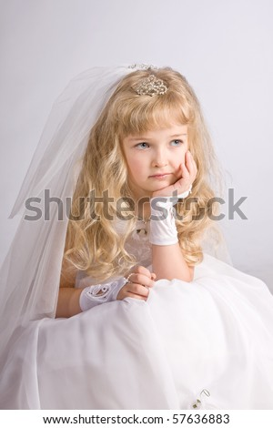The little girl in a dress of the bride - stock photo