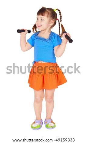 The little girl in a dress with dumbbells in hands on a white background - stock photo