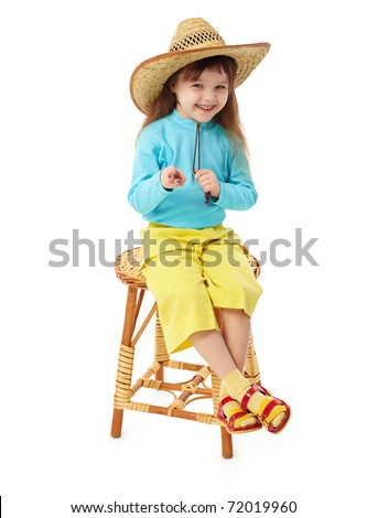 The little girl in a straw hat sitting on an old-fashioned wooden chair - stock photo