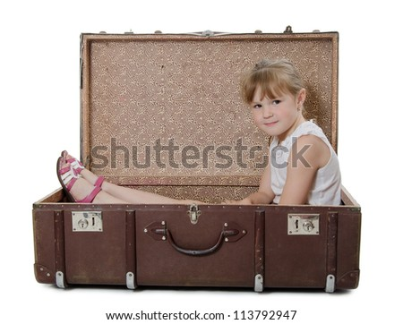 The little girl in an old suitcase