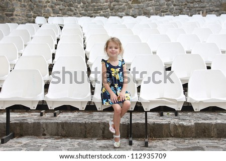 The little girl in the audience - stock photo