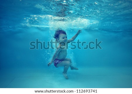 underwater water park. The Little Girl In Water Park Swimming Underwater And Smiling L
