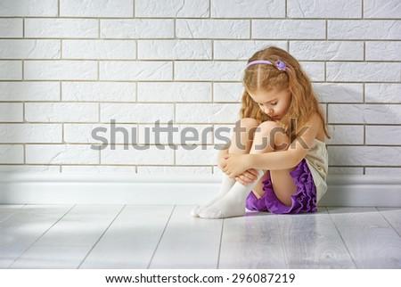 the little girl is afraid - stock photo