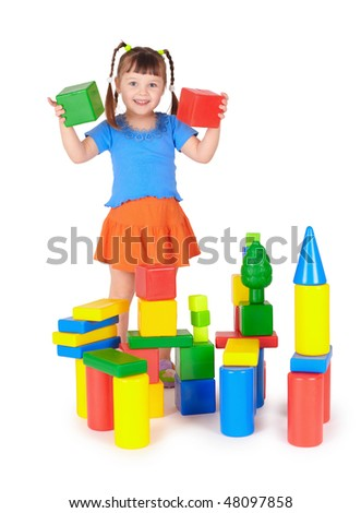 The little girl is playing with colored blocks - stock photo