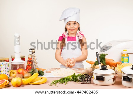 The little girl is preparing in the kitchen