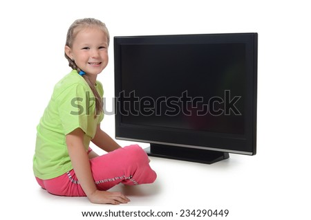The little girl looks at tv isolated - stock photo