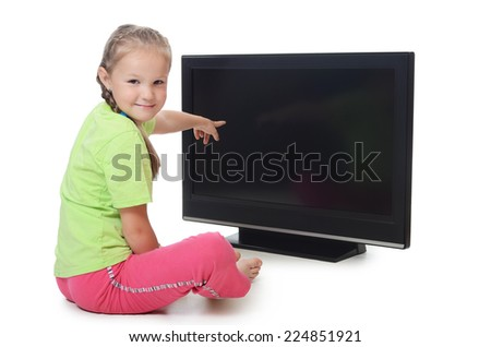 The little girl looks lsd tv isolated - stock photo