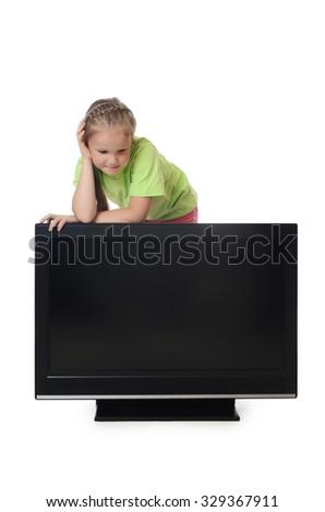 The little girl looks lsd tv isolated - stock photo