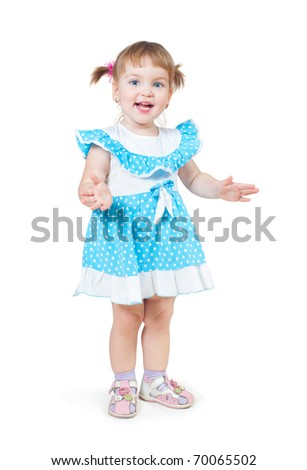 The little girl of two years costs on a white background