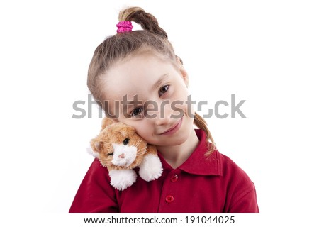 the little girl on his shoulder a toy cat - stock photo