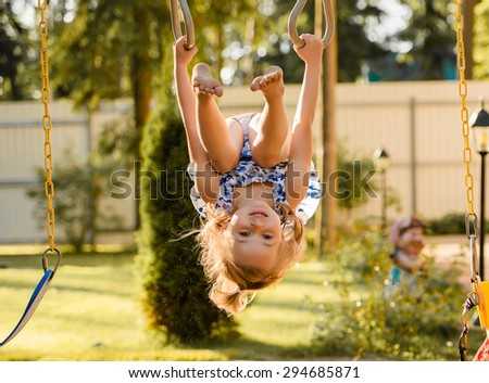 the little girl on the playground - stock photo