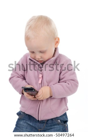 The little girl playing with a mobile phone