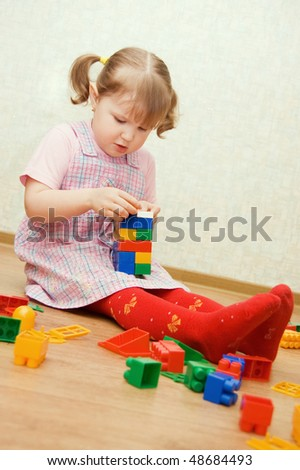 The little girl plays to a room