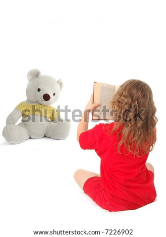 The little girl reads the book isolated on white background - stock photo