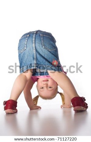 the little girl showing her butt - stock photo