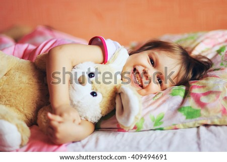 The little girl sleeping on the bed. - stock photo