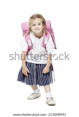 the little girl smiles . white background with pink backpack - stock photo