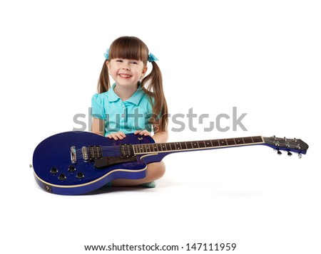 the little girl with a blue guitar on a white background