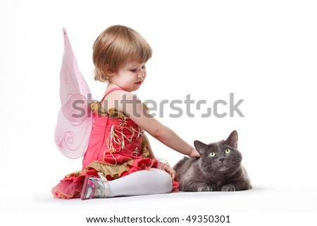 The little girl with a cat - stock photo