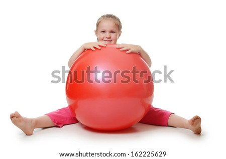 The little girl with a gymnastic ball - stock photo
