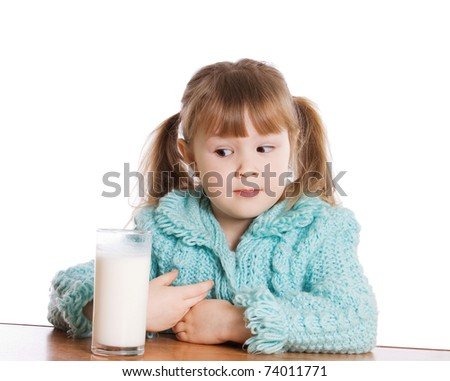 The little girl with a milk glass - stock photo