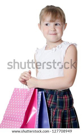 The little girl with a Two packages - stock photo