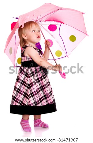 The little girl with an umbrella - stock photo