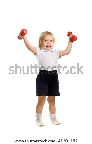 The little girl with dumbbells - stock photo