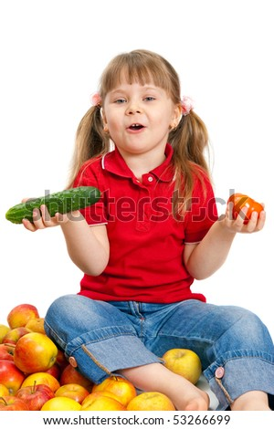 The little girl with fruit and vegetables isolated on white background - stock photo