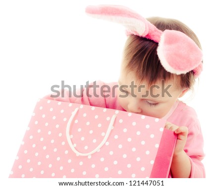 The little girl with pink ears bunny and bag on white background. - stock photo
