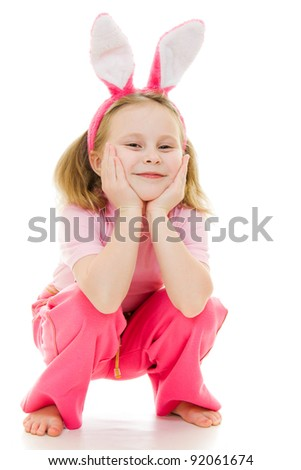The little girl with pink ears bunny on white background. - stock photo