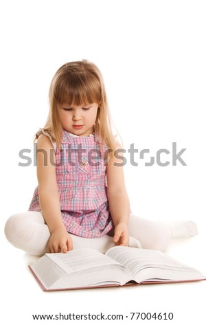 The little girl with the book - stock photo