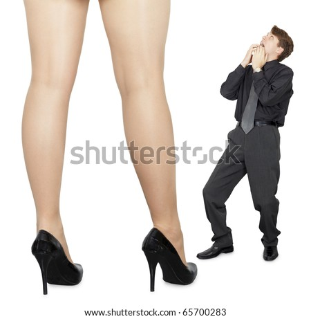 The little man is shocked by the appearance of big women isolated on white background - stock photo