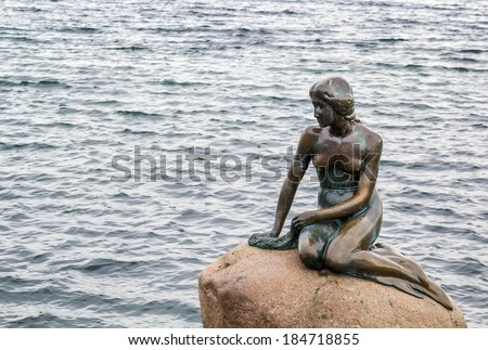 The Little Mermaid is a bronze statue by Edvard Eriksen, depicting a mermaid. The sculpture is displayed on a rock by the waterside at the Langelinie promenade in Copenhagen, Denmark - stock photo