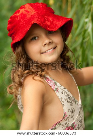 The little smiling girl in a red hat