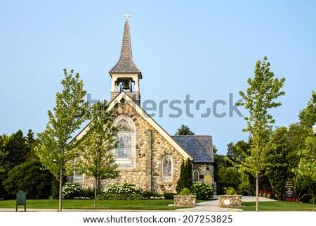 The Little Stone Church located on Mackinaw Island, Michigan. - stock photo