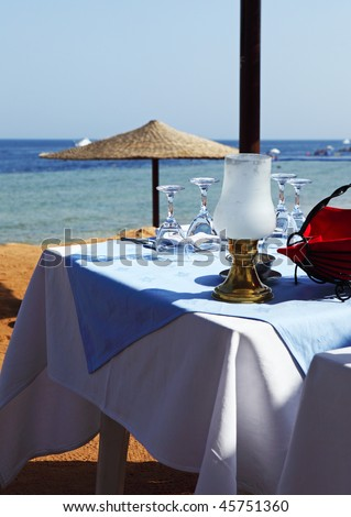 The little table is served on beach Sharks Bay, Sharm El Sheikh, Egypt