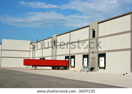 The loading dock at a large warehouse facility - stock photo