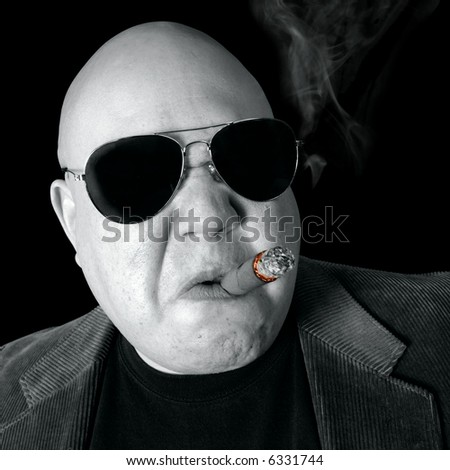 The Loan Shark, Boss, Head Honcho, Top Dog...  An image of the Man in charge, smoking a cigar. - stock photo