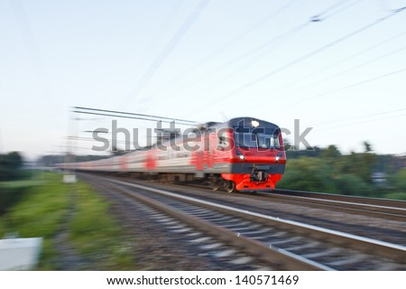The local train passes by at great speed - stock photo