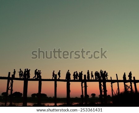 The locals go for teak bridge U Bein at sunset. Mandalay Burma