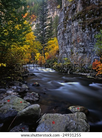The Logan River in Utah, photographed during the autumn season. - stock photo