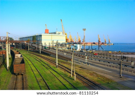 The logistics center. The transportation hub. A Railroad, a highway and a seaport. - stock photo
