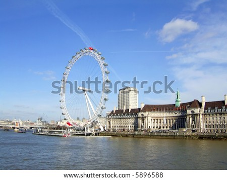 The London Eye and Thames River in London, England. (For Editorial Use Only)