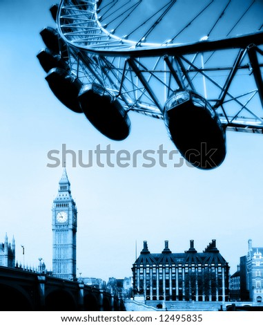 The London Eye, Big Ben, houses of Parliament, and the Thames landmarks of London in blue tone - stock photo