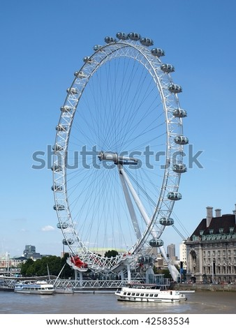 The London Eye Seen from Across the Thames - stock photo